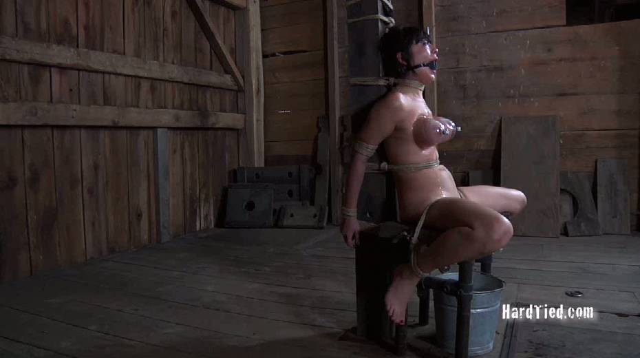 Asian gal with ball gag in her mouth is tied up and fucked with vibrator - 3. pic