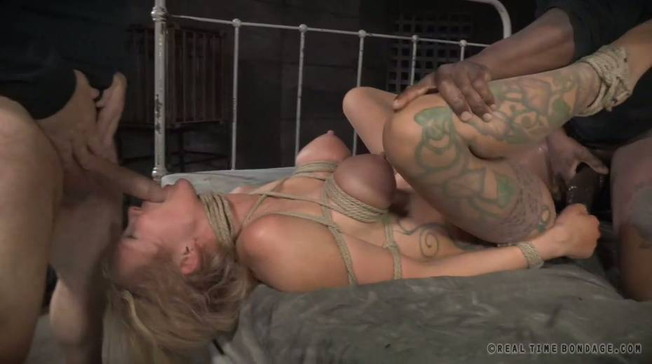 Lustful big boobed slave with tattoos gets brutally fucked by two masters - 9. pic