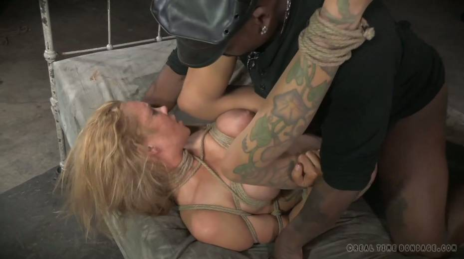 Lustful big boobed slave with tattoos gets brutally fucked by two masters - 12. pic