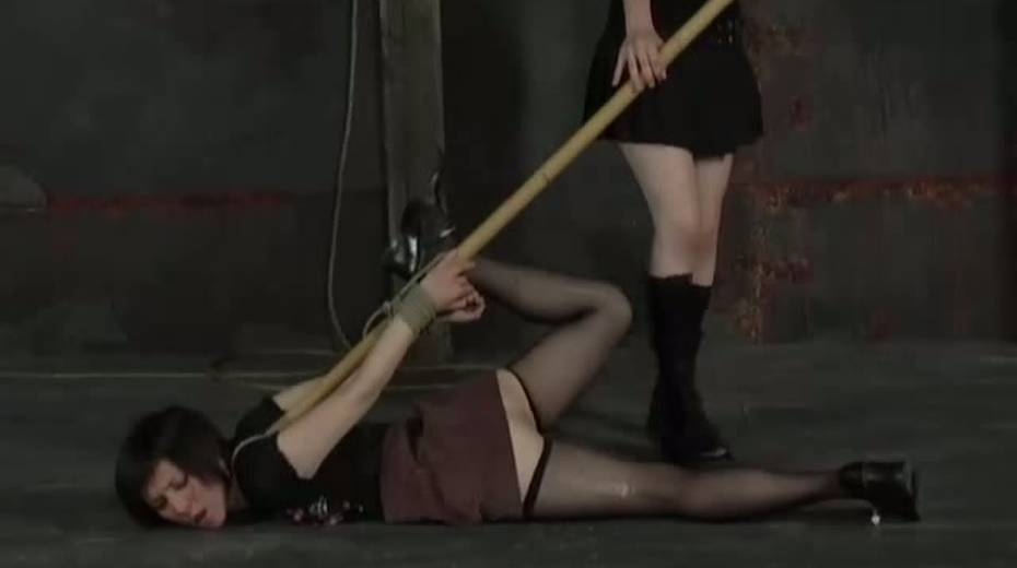 Chick wearing ripped pantyhose licks master's boots and he fucks her with long stick - 6. pic