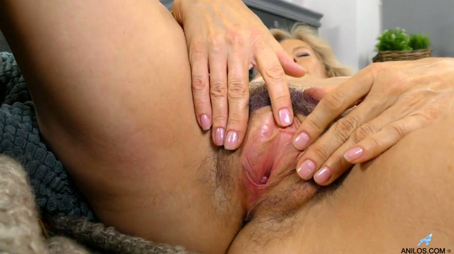 Mature blonde Diana Gold is finger fucking her wet and whorish punani - 18. pic
