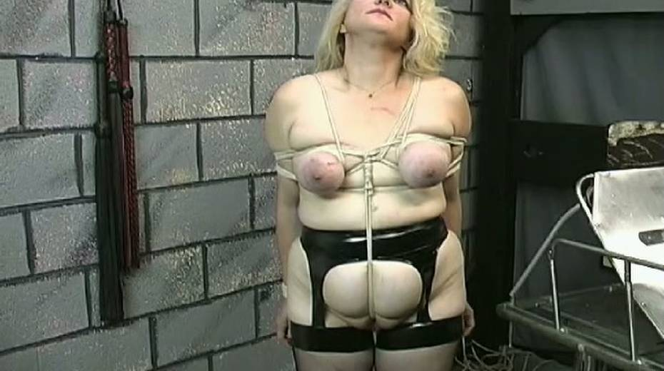 Obese slut with tied up boobs is punished in the bdsm room - 1. pic