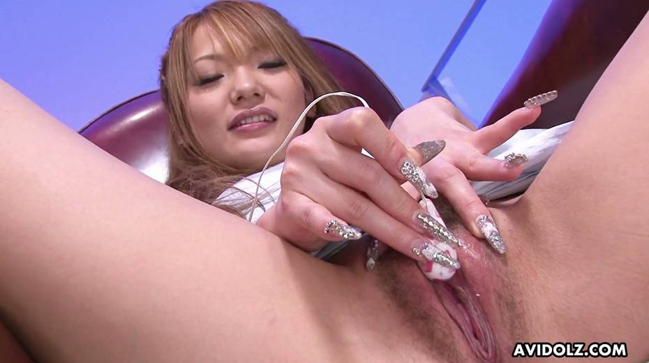 Asian fancy girl Sena Aragaki gets her pussy toying spreading legs wide open - 21. pic
