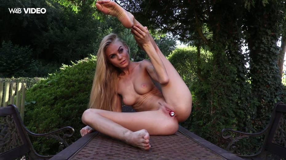 Eye catching babe Nancy A is masturbating her pussy in the garden - 10. pic