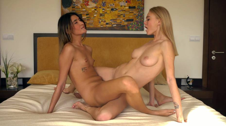 Two beautiful girls are making love and kissing in scissor position - 24. pic