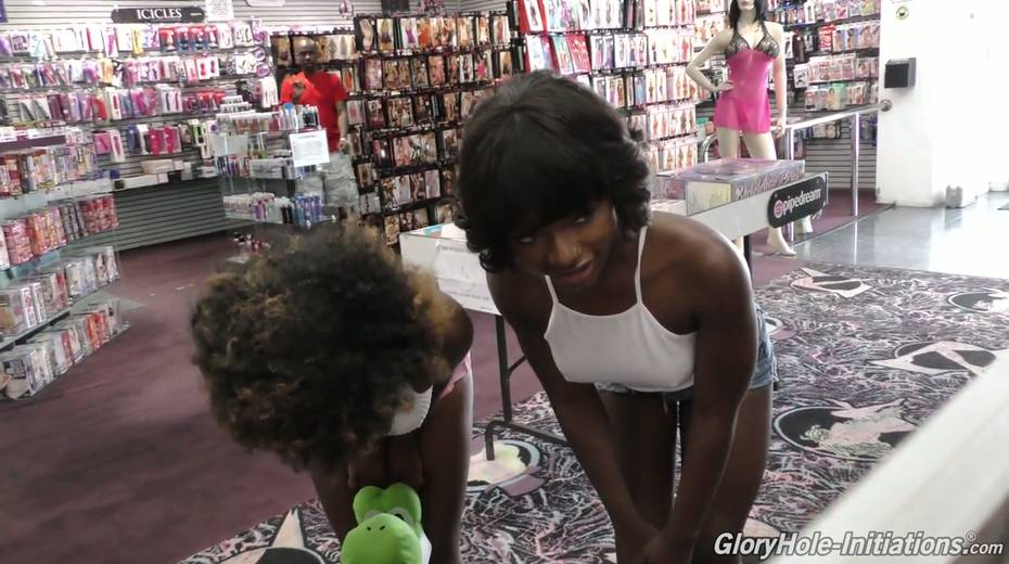 Black chick Noemie Bilas and her kinky girlfriend go wild in the glory hole room - 2. pic