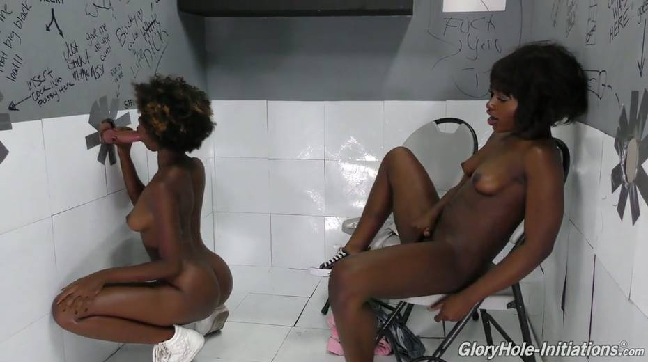 Black chick Noemie Bilas and her kinky girlfriend go wild in the glory hole room - 10. pic