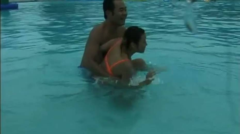 Two frisky Jap girls bathing in a pool having much fun - 2. pic