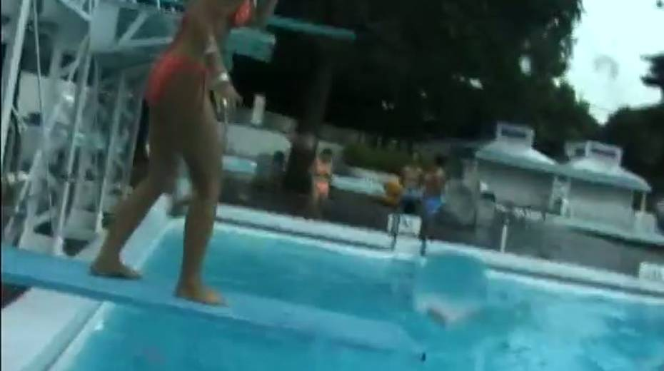 Two frisky Jap girls bathing in a pool having much fun - 5. pic