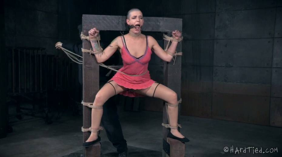 Restrained bald headed gal is punished in the torture room - 6. pic