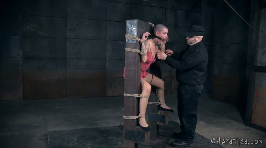 Restrained bald headed gal is punished in the torture room - 11. pic