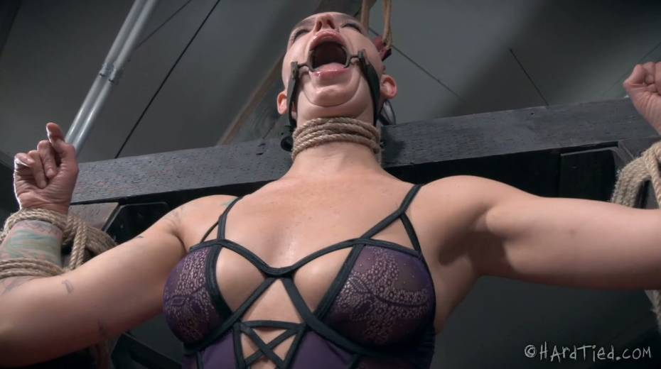 Restrained bald headed gal is punished in the torture room - 14. pic